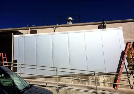 Williams Mechanical Service installs large freezer units on new construction